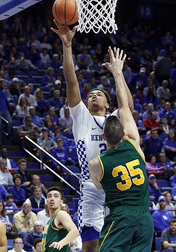 Kentucky's P.J. Washington, top, shoots between Vermont's Payton Henson (35) and Everett Duncan during the second half of an NCAA college basketball game, Sunday, Nov. 12, 2017, in Lexington, Ky.