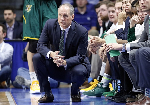 Vermont head coach John Becker watches his team during the second half of an NCAA college basketball game against Kentucky, Sunday, Nov. 12, 2017, in Lexington, Ky. Kentucky won 73-69.