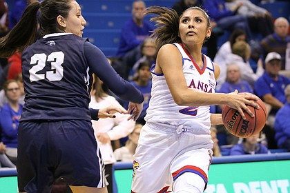 Senior guard Briana Osorio drives through the lane during KU's win over Oral Roberts in Allen Fieldhouse Tuesday Nov. 13, 2018.