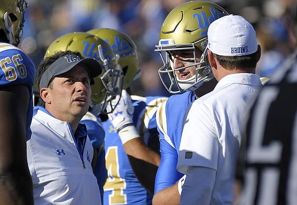 UCLA offensive coordinator Jedd Fisch, left, talks with quarterback Josh Rosen, center, and head coach Jim Mora during the second half of an NCAA college football game against Oregon, Saturday, Oct. 21, 2017 in Pasadena, Calif. UCLA won 31-14. (AP Photo/Mark J. Terrill)