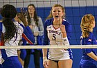 KU senior Gabby Simpson celebrates a point against Kansas State in a match Wednesday night at Horejsi Family Athletics Center.