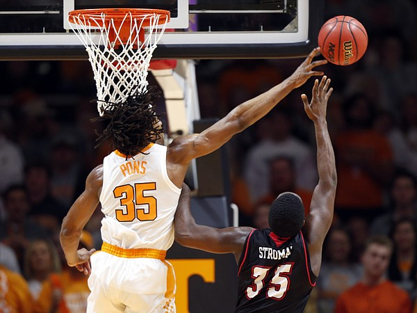 Tennessee forward Yves Pons (35) blocks the shot of Louisiana-Lafayette guard Marcus Stroman (35) during the first half of an NCAA college basketball game Friday, Nov. 9, 2018, in Knoxville, Tenn. (AP photo/Wade Payne)
