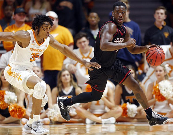 Louisiana-Lafayette forward Malik Marquetti (1) dribbles past Tennessee forward Yves Pons (35) during the second half of an NCAA college basketball game Friday, Nov. 9, 2018, in Knoxville, Tenn. Tennessee won 87-65. (AP photo/Wade Payne)