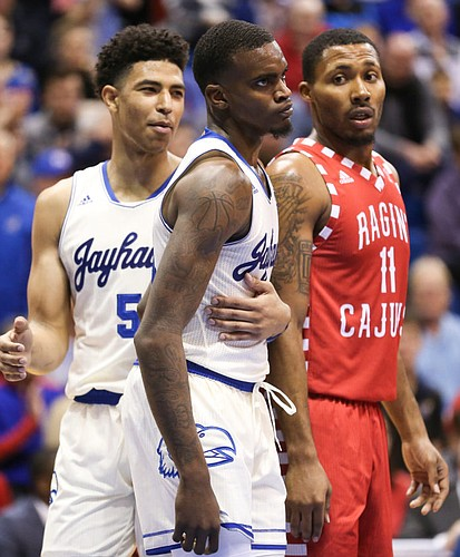 Kansas guard Quentin Grimes (5) holds back Kansas guard Lagerald Vick (24) after Vick was fouled on a drive during the first half, Friday, Nov. 16, 2018 at Allen Fieldhouse. At right is Louisiana forward Jerekius Davis (11).