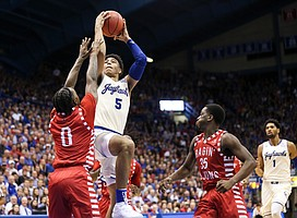 Kansas guard Quentin Grimes (5) pulls up for a shot against Louisiana guard Cedric Russell (0) during the second half, Friday, Nov. 16, 2018 at Allen Fieldhouse.