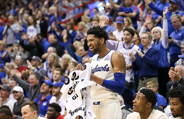 Kansas forward Dedric Lawson (1) laughs after a dunk and celebration by teammate Udoka Azubuike during the second half, Friday, Nov. 16, 2018 at Allen Fieldhouse.