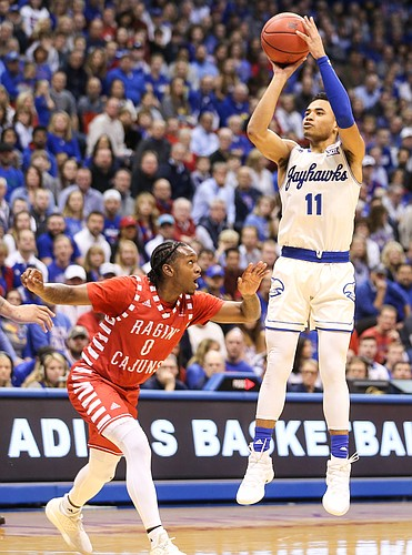 Kansas guard Devon Dotson (11) puts up a shot over Louisiana guard Cedric Russell (0) during the first half, Friday, Nov. 16, 2018 at Allen Fieldhouse.