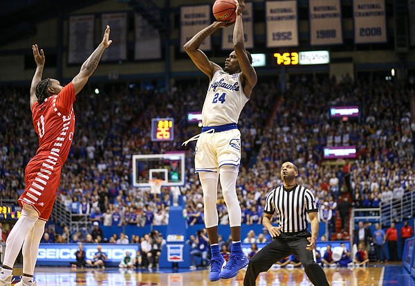 Kansas guard Lagerald Vick (24) pulls up for a three over Louisiana guard Cedric Russell (0) during the first half, Friday, Nov. 16, 2018 at Allen Fieldhouse.