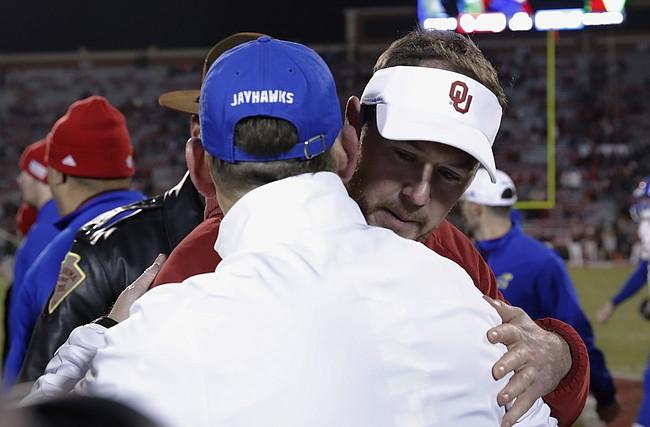 Oklahoma head coach Lincoln Riley, back, and Kansas head coach David Beaty, front, meet mid field following an NCAA college football game in Norman, Okla., Saturday, Nov. 17, 2018. Oklahoma won 55-40. (AP Photo/Alonzo Adams)