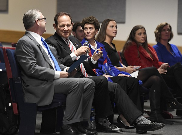 University of Kansas Athletic Director Jeff Long, left, and newly hired football coach Les Miles, second from left, share a smile Sunday, Nov. 18, 2018, at Hadl Auditorium.