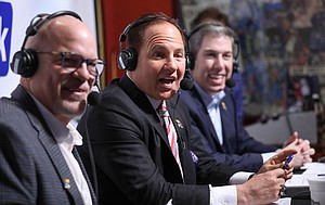 "Newly-hired Kansas head football coach Les Miles shares the story of how he met his wife between radio broadcasters David Lawrence, left, and Brian Hanni, back right, during the ""Hawk Talk"" radio show on Sunday, Nov. 18, 2018, at Johnny's West in Lawrence."