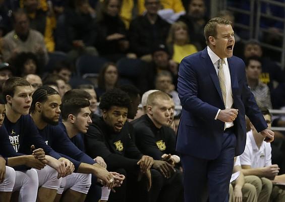 Marquette's Steve Wojciechowski yells to his team during the first half of an NCAA college basketball game against Villanova, Sunday, Jan. 28, 2018, in Milwaukee. (AP Photo/Tom Lynn)