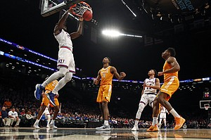 Kansas center Udoka Azubuike (35) dunks in front of Tennessee forward Kyle Alexander (11) during the first half of an NCAA college basketball game in the NIT Season Tip-Off tournament Friday, Nov. 23, 2018, in New York. (AP Photo/Adam Hunger)