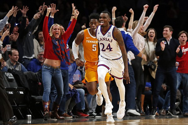 Kansas guard Lagerald Vick (24) reacts after making a 3-point basket, in front of Tennessee guard Admiral Schofield (5) during the second half of an NCAA college basketball game in the NIT Season Tip-Off tournament Friday, Nov. 23, 2018, in New York. Kansas defeated Tennessee 87-81 in overtime. (AP Photo/Adam Hunger)