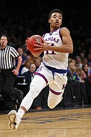 Kansas guard Devon Dotson drives to the basket against Tennessee during the first half of an NCAA college basketball game in the NIT Season Tip-Off tournament Friday, Nov. 23, 2018, in New York. (AP Photo/Adam Hunger)