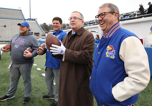 Kansas athletic director Jeff Long stands along the sidelines before kickoff with chancellor Douglas Girod on Friday, Nov. 23, 2018 at Memorial Stadium.