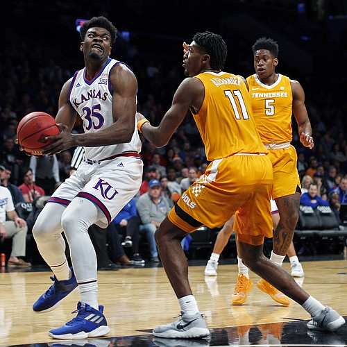 Kansas center Udoka Azubuike (35) looks to the basket as Tennessee forward Kyle Alexander (11) defends during the first half of an NCAA college basketball game in the NIT Season Tip-Off tournament Friday, Nov. 23, 2018, in New York. Kansas won 87-81 in overtime. (AP Photo/Adam Hunger)