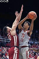 Stanford forward Oscar da Silva (13) takes a shot over Washington State forward Drick Bernstine (43) during the first half of an NCAA college basketball game Saturday, Feb. 24, 2018, in Stanford, Calif. (AP Photo/Tony Avelar)