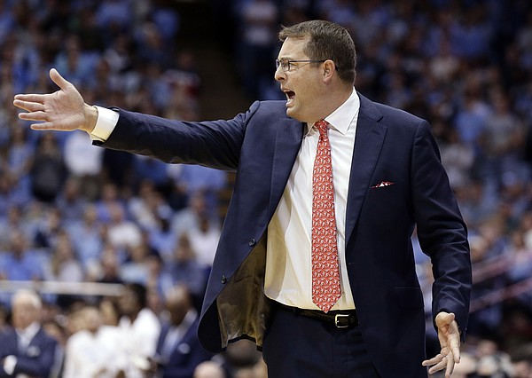 Stanford head coach Jerod Haase directs his players during the first half of an NCAA college basketball game against North Carolina in Chapel Hill, N.C., Monday, Nov. 12, 2018. (AP Photo/Gerry Broome)