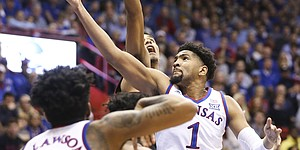 Kansas forward Dedric Lawson (1) curls around to put up a shot during the first half on Saturday, Dec. 1, 2018 at Allen Fieldhouse.