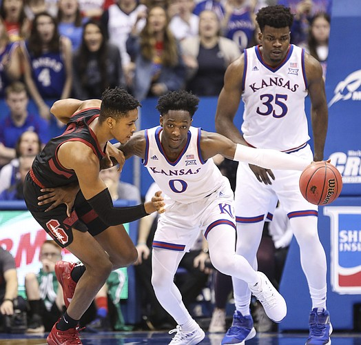 Kansas guard Marcus Garrett (0) steals a ball from Stanford forward KZ Okpala (0) during the second half on Saturday, Dec. 1, 2018 at Allen Fieldhouse.