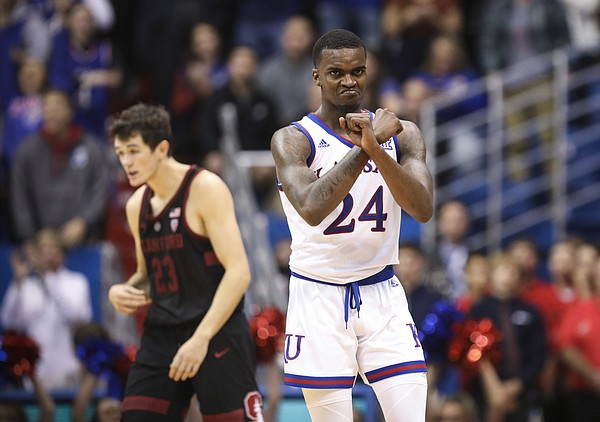 Kansas guard Lagerald Vick (24) celebrates a run by The Jayhawks in overtime on Saturday, Dec. 1, 2018 at Allen Fieldhouse. Vick scored 27 points and hit a game-tying shot to send the game into overtime.