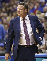 Kansas head coach Bill Self flashes a smile as the Jayhawks pull away during overtime on Saturday, Dec. 1, 2018 at Allen Fieldhouse.