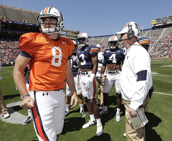 Auburn quarterback Jarrett Stidham with offensive coordinator Chip Lindsey in the second half of Auburn A-Day NCAA college football game on Saturday, April 8, 2017 in Auburn, Ala. (AP Photo/Todd J. Van Emst)