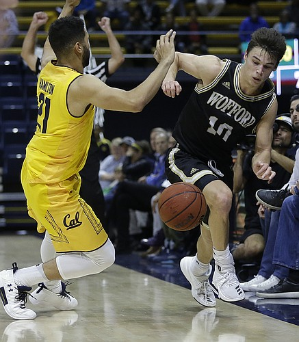 Wofford's Nathan Hoover, right, drives the ball against California's Nick Hamilton, left, during the second half of an NCAA college basketball game Thursday, Nov. 16, 2017, in Berkeley, Calif. (AP Photo/Ben Margot)