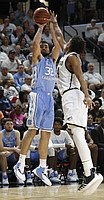 North Carolina's Luke Maye (32) shoots a 3-pointer over Wofford's Keve Aluma (24) during the second half of an NCAA college basketball game in Spartanburg, S.C., Tuesday, Nov. 6, 2018. North Carolina won 78-67. (AP Photo/Bob Leverone)