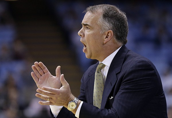 Wofford coach Mike Young directs his team during the first half of an NCAA college basketball game against North Carolina in Chapel Hill, N.C., Wednesday, Nov. 18, 2015. (AP Photo/Gerry Broome)