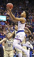 Kansas guard Devon Dotson (11) floats in for a bucket during the first half against Wofford on Tuesday, Dec. 4, 2018 at Allen Fieldhouse.