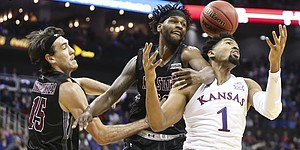 Kansas forward Dedric Lawson (1) tangles with New Mexico State forward C.J. Bobbitt (13) and New Mexico State forward Ivan Aurrecoechea (15) as they fight for a rebound during the first half on Saturday, Dec. 8, 2018 at Sprint Center.