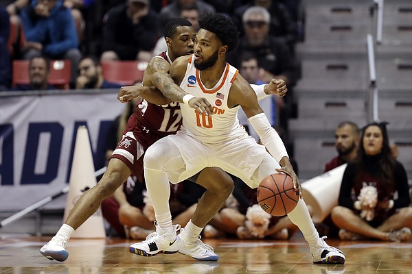 New Mexico State guard A.J. Harris (12) guards Clemson guard Gabe DeVoe (10) during the first half of a first-round NCAA college basketball tournament game Friday, March 16, 2018, in San Diego. (AP Photo/Gregory Bull)