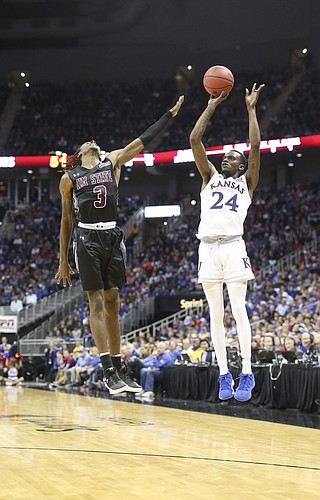 Kansas guard Lagerald Vick (24) puts up a three over New Mexico State guard Terrell Brown (3) during the second half on Saturday, Dec. 8, 2018 at Sprint Center.