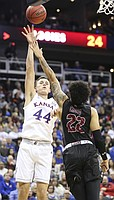 Kansas forward Mitch Lightfoot (44) turns for a shot over New Mexico State forward Eli Chuha (22) during the first half on Saturday, Dec. 8, 2018 at Sprint Center.