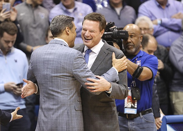 Kansas head coach Bill Self and Villanova head coach Jay Wright greet each other before tipoff, Saturday, Dec. 15, 2018 at Allen Fieldhouse.