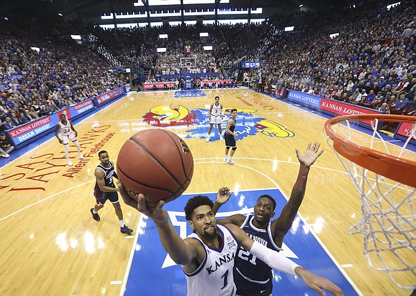 Kansas forward Dedric Lawson (1) gets in for a bucket past Villanova forward Dhamir Cosby-Roundtree (21) during the second half, Saturday, Dec. 15, 2018 at Allen Fieldhouse.