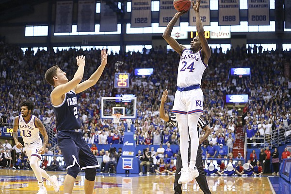 Kansas guard Lagerald Vick (24) pulls up for a three from the wing over Villanova guard Collin Gillespie (2) during the first half, Saturday, Dec. 15, 2018 at Allen Fieldhouse.