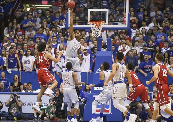 Kansas forward David McCormack (33) gets up to reject a shot from South Dakota guard Nathan Robinson (24) during the second half, Tuesday, Dec. 18, 2018 at Allen Fieldhouse.