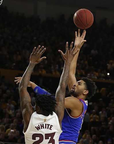 Kansas guard Devon Dotson shoots over Arizona State forward Romello White (23) during the first half of an NCAA college basketball game Saturday, Dec. 22, 2018, in Tempe, Ariz. (AP Photo/Rick Scuteri)