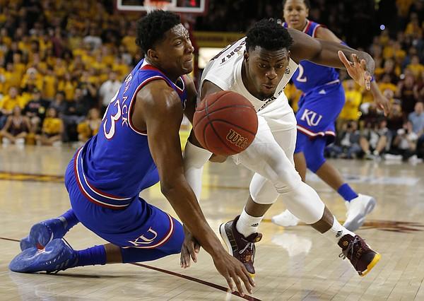 Kansas forward David McCormack (33) and Arizona State guard Luguentz Dort scramble for the ball during the first half during an NCAA college basketball game Saturday, Dec. 22, 2018, in Tempe, Ariz. (AP Photo/Rick Scuteri)