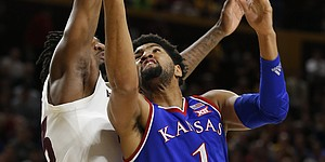 Kansas forward Dedric Lawson (1) shoots next to Arizona State forward Romello White during the first half of an NCAA college basketball game Saturday, Dec. 22, 2018, in Tempe, Ariz. (AP Photo/Rick Scuteri)