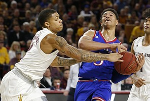 Arizona State guard Rob Edwards, left, knocks the ball away from Kansas guard Quentin Grimes during the first half of an NCAA college basketball game Saturday, Dec. 22, 2018, in Tempe, Ariz. (AP Photo/Rick Scuteri)