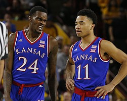 Kansas guard Lagerald Vick (24) and Devon Dotson (11) in the first half during an NCAA college basketball game against Arizona State, Saturday, Dec. 22, 2018, in Tempe, Ariz. (AP Photo/Rick Scuteri)
