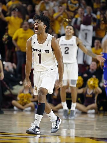 Arizona State guard Remy Martin (1) celebrates in the second half of the team's NCAA college basketball game against Kansas, Saturday, Dec. 22, 2018, in Tempe, Ariz. Arizona State won 80-76. (AP Photo/Rick Scuteri)