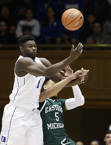 Duke's Zion Williamson (1) and Eastern Michigan's Elijah Minnie (5) struggle for possession of the ball during the first half of an NCAA college basketball game in Durham, N.C., Wednesday, Nov. 14, 2018. (AP Photo/Gerry Broome)