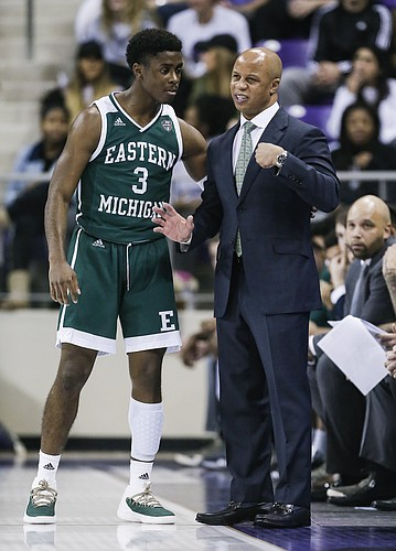 Eastern Michigan guard Paul Jackson (3) and head coach Rob Murphy during the first half of an NCAA college basketball game against TCU, Monday, Nov. 26, 2018, in Fort Worth, Texas. TCU won 87-69. (AP Photo/Brandon Wade)