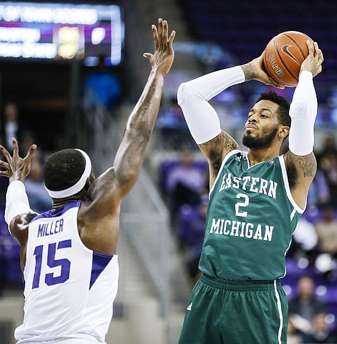 Eastern Michigan forward James Thompson IV (2) looks for room against TCU forward JD Miller (15) during the first half of an NCAA college basketball game, Monday, Nov. 26, 2018, in Fort Worth, Texas. TCU won 87-69. (AP Photo/Brandon Wade)