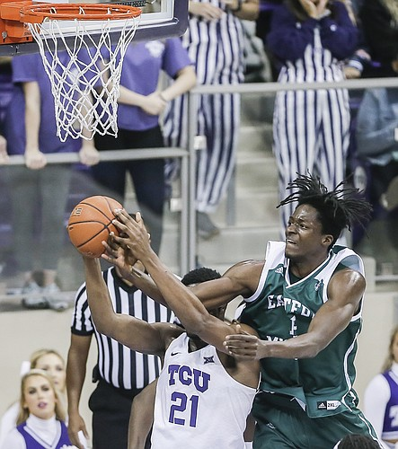 TCU forward Kevin Samuel (21) and Eastern Michigan forward Boubacar Toure (12) battle for a rebound during the second half of an NCAA college basketball game, Monday, Nov. 26, 2018, in Fort Worth, Texas. TCU won 87-69. (AP Photo/Brandon Wade)